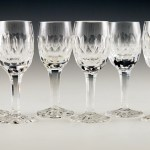 Set of six rock crystal stemware goblets with drawn stems and cut decor. Hand blown and hand cut.