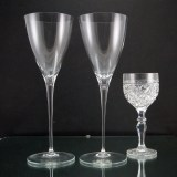 "Vintage Tiffany crystal goblets command attention at 10.5"" tall. Shown in image one with a normal size wine glass for comparison. Produces a fine lingering ting when plinked. Perfect for the wedding toast."