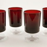 Set of four vintage ruby glass goblets marked France.