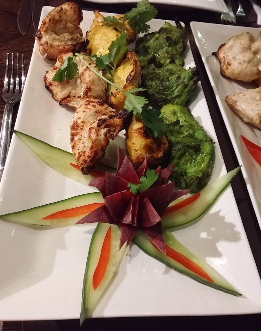 Appetisers of taranga chicken tikka in Indian flag colour: Green: hari chicken tikka (coriander, mint, chilli marinade) White: kaali mirch (black pepper, lychee marinade) Yellow: kesari murgj (saffron infused)
