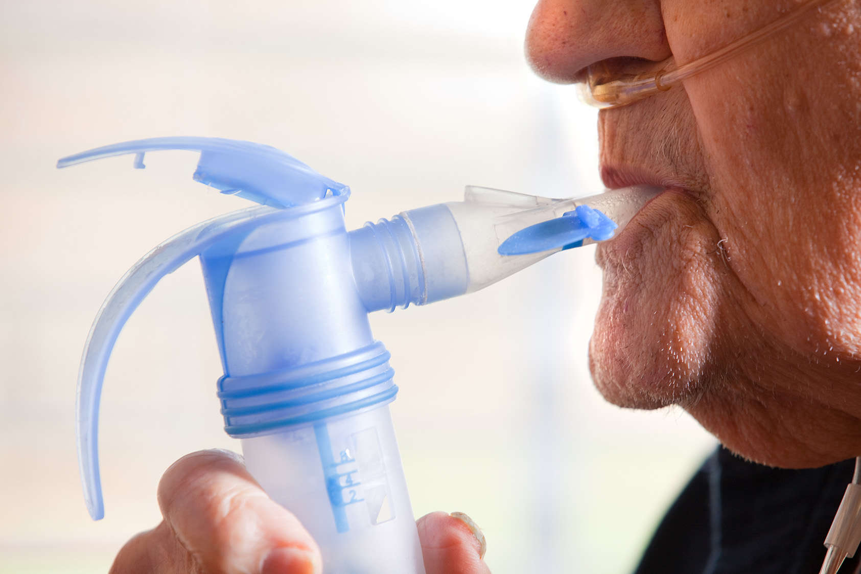 Close Up Of Elderly Man Using Nebulizer