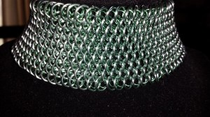A month in the making, this is a 2 inch wide, 14 inch long dragonscale choker.. seafoam green with emerald green
