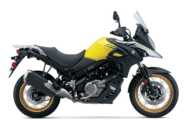 The 2017 Suzuki V-Strom 650XT features spoked wheels with tubeless tires, hand guards and an engine cowl. Bikes in the Champion Yellow No. 2 paint scheme get special gold wheels.