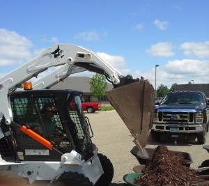 Mulch installation with a skid steer