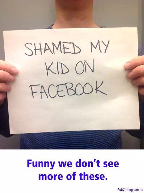 Man holding sign saying 'Shamed My Kid on Facebook'
