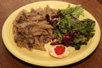 Penne with caramelized onion, mushroom and white bean sauce, accompanied by mixed green salad and cracker with red pepper eggplant spread