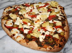 Whole wheat pizza with mozzarella and feta cheese