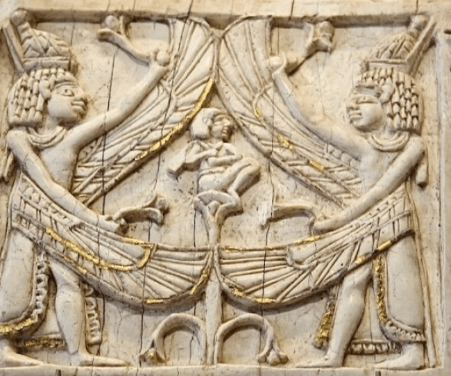 Ivory Plaque from 10th-9th century Samaria depicting winged being with Egyptian crowns protecting a seated figure (foto thetorah)