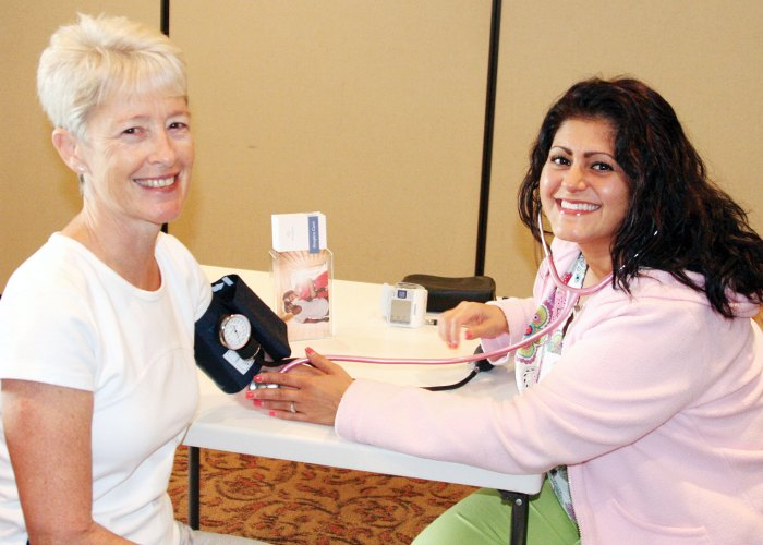 Debra Davis and the VNA for her monthly blood pressure check