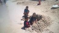 On the beach building a sand castle