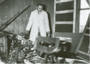 Chambers searches through his firebombed office in Charlotte, NC in February of 1971.