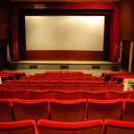 In Mumbai going for a movie is still a communal experience;  the  auditorium  is  packed, there are people to shush and the commentary is immediate. In the US... on an average movie night, it's a few heads bobbing ominously  in  a  sea of  seats. Photo: Wikimedia commons