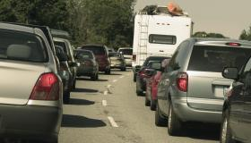 Cars stuck in rush hour traffic, rear view