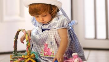 Toddler with Easter eggs and basket