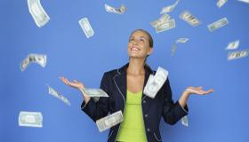 money falling around a businesswoman