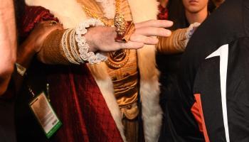 The Burger King & Justin Bieber walk alongside Floyd Mayweather as he enters MGM Arena in Las Vegas