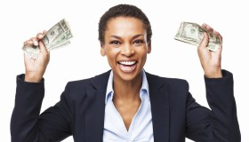 African American Businesswoman Holding Handful Of Money - Isolated