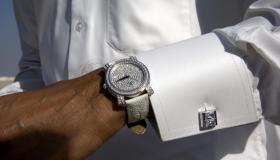 A Qatari wears a diamond-studded watch.
