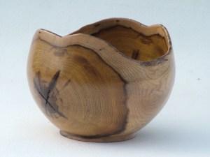 turned laburnam bowl showing a star shake
