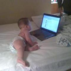 Judah checking facebook 1st thing this am, he is addicted
