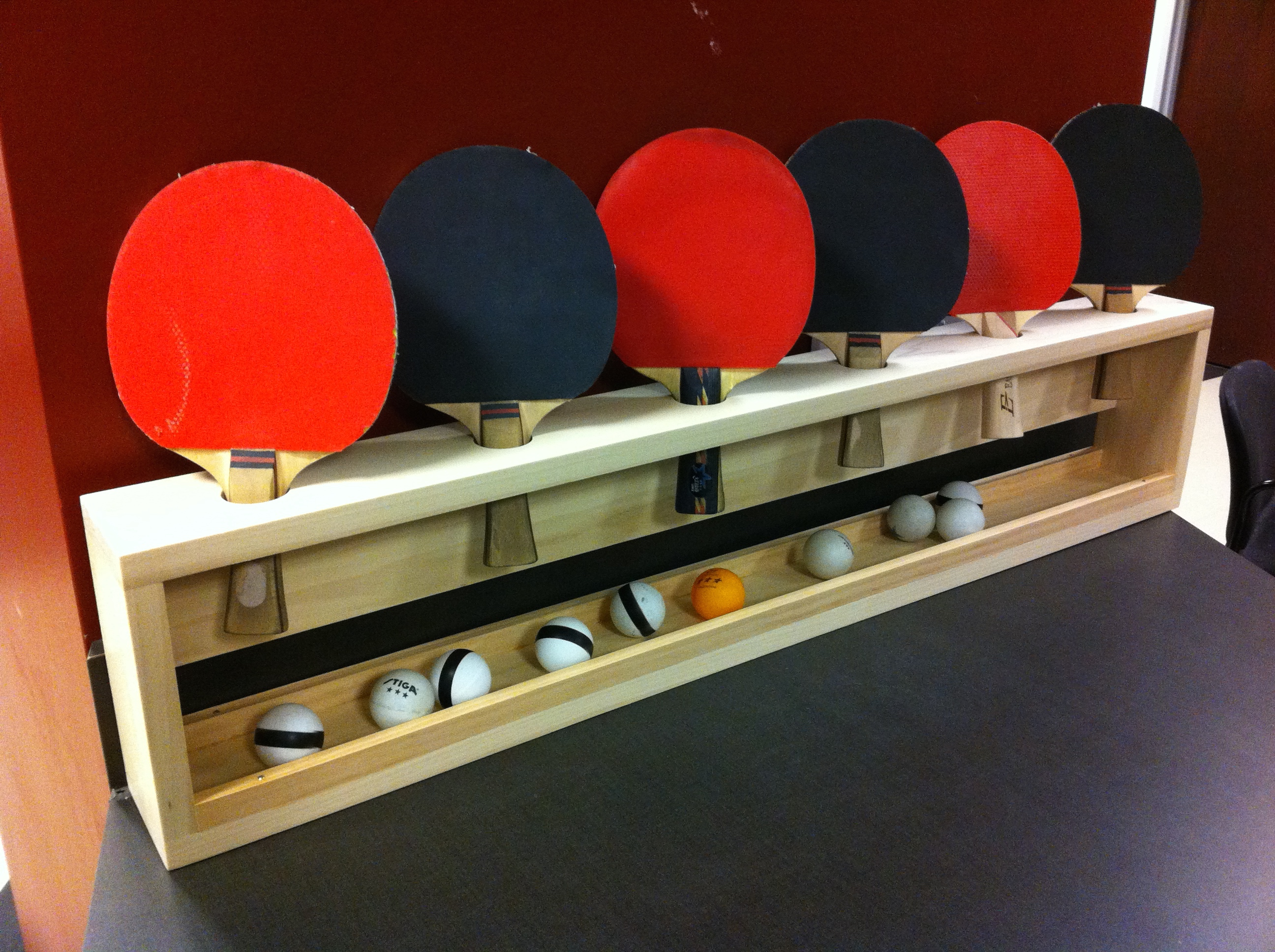 Office ping pong paddle rack ryan j turek - How much space for a ping pong table ...