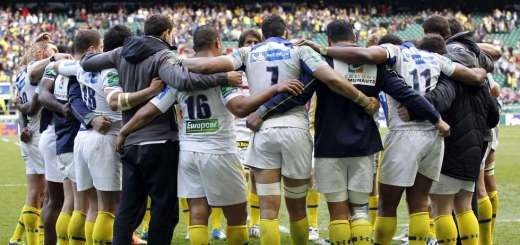 Clermont Auvergnes players huddle togeth