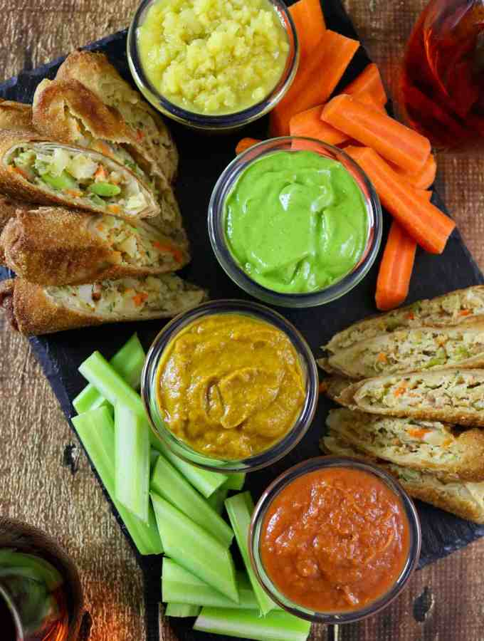 Girl's Night in with Van's Kitchen Egg Rolls and tomato pineapple dip, curried pumpkin dip, apple chutney dip and avocado spinach dip. #EggRollWithIt #ad