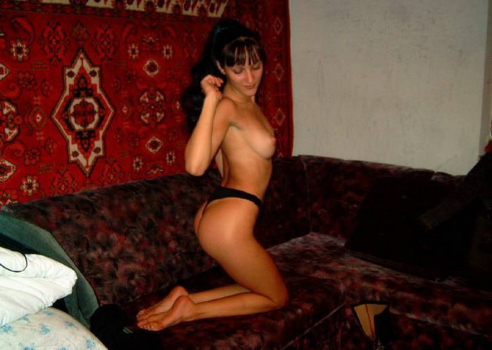 Russian husband is taking picture of his nasty wife with her tits naked