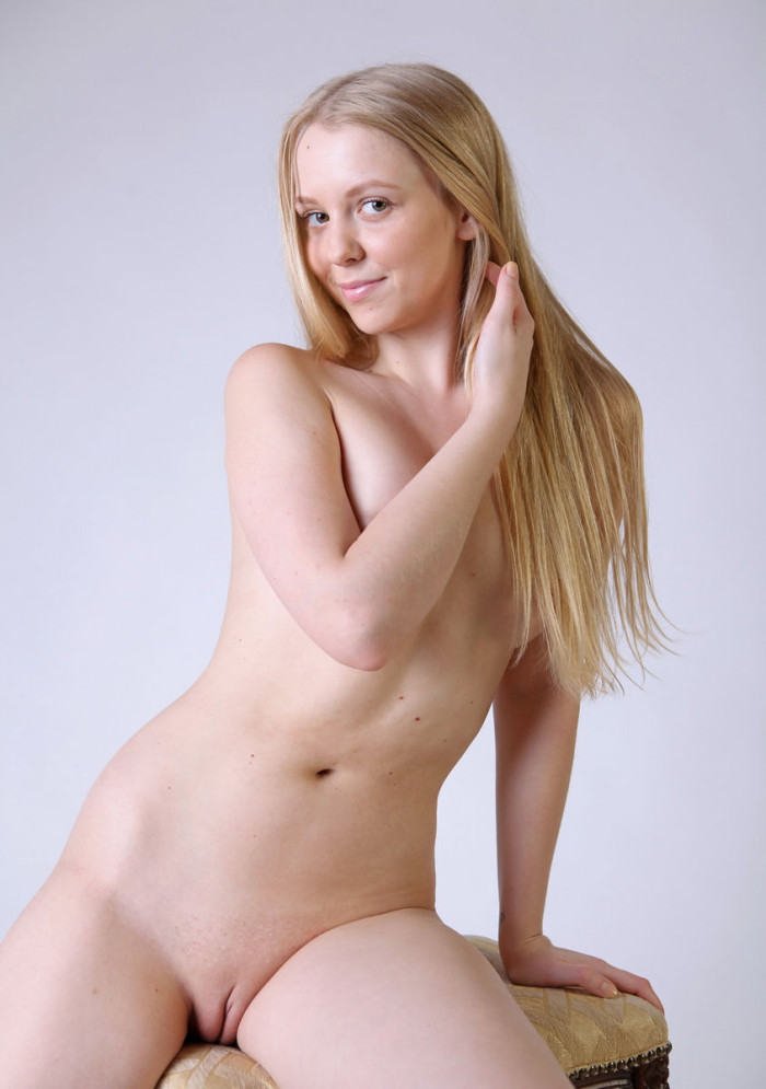 Naked blonde Irina posing at forest