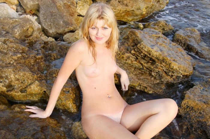 Long-haired blonde Erica B shows herself at the coast