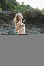Blue-eyed-Stella-Lanes-frolicking-naked-in-the-beach-2.jpg