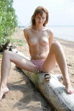 Eriska-A-displays-her-smooth-creamy-body-with-puffy-tits-on-the-beach.-1.jpg