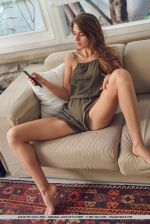 Kalisy-strips-on-the-sofa-as-she-shows-off-her-slender-body-and-delectable-pussy.-2.jpg