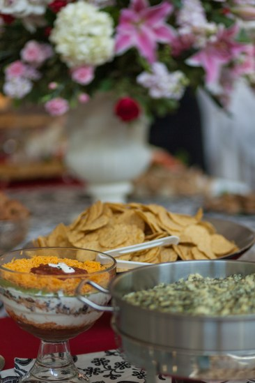 Lovely layered bean dip and spinach artichoke dip with a beautiful bouquet of flowers