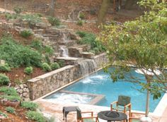 pool slide...retaining wall & slide on hill