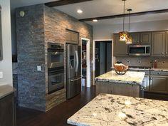 Mushroom painted cabinets with charcoal glaze splendor white granite