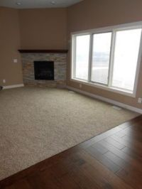 Carpet inlay wood floor bordering 3 feet around room wall ...