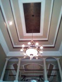Wallpaper in a tray ceiling...or stencil with clear gloss ...