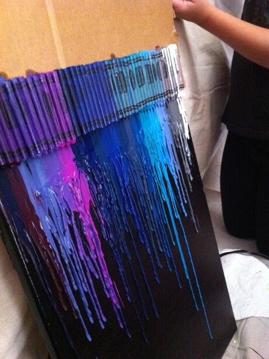 Melted crayon art! so THATS how they do it without the crayons glued to the actu