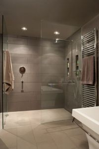 Modern gray shower. Horizontal gray shower tile. Towel ...