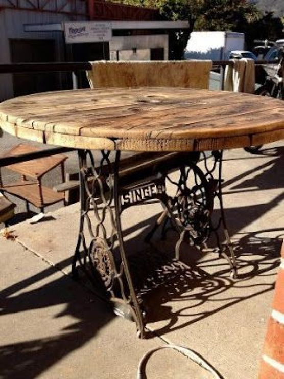 Love this! Table made from Singer sewing machine base and old cable spool: