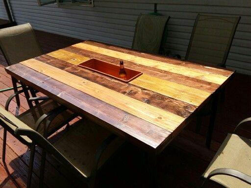 Replaced broken glass top on patio table with 2x6 boards
