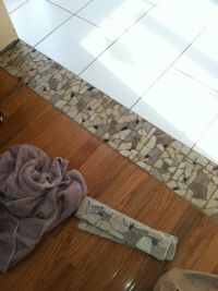 Stone threshold between tile and wood