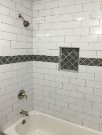 Large white subway tile with dark gray grout and gray ...