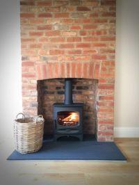 Charnwood C-Five riven slate hearth brick fireplace.jpg ...