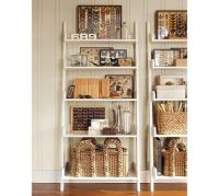 Leaning wall shelf from Pottery Barn...toy storage idea ...
