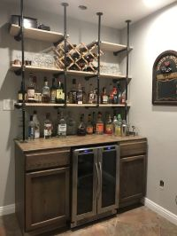 Gas pipe shelves over rustic bar | DIY home bar ...