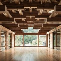maze like wood ceiling + hardwood flooring to match+ glass ...
