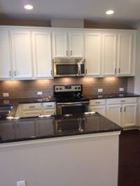 My new kitchen! White cabinets, tan subway tile backsplash ...