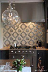 designer navy-grey kitchen with geometric terra-cota tile ...